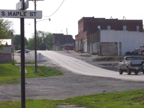 Main street Skidmore, Missouri where the shooting took place on July 10, 1981. Where the white car is parked is roughly where Ken McElroy's pickup was when he was shot. Photo taken by me in 2007.